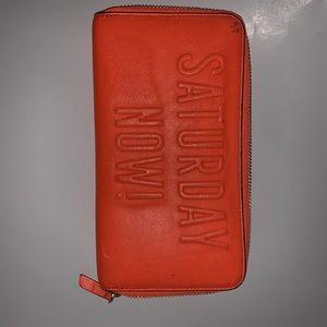 Bright orange Kate Spade Wallet